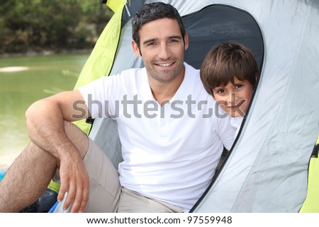 Daddy took me camping. - stock photo
