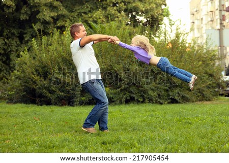daddy with daughter at the park  - stock photo