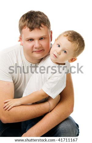 daddy with the son in white T-shirts, the daddy embraces the son, isolated on white - stock photo
