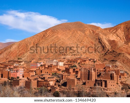 dades valley wild landscape and kasbah village in Morocco - stock photo