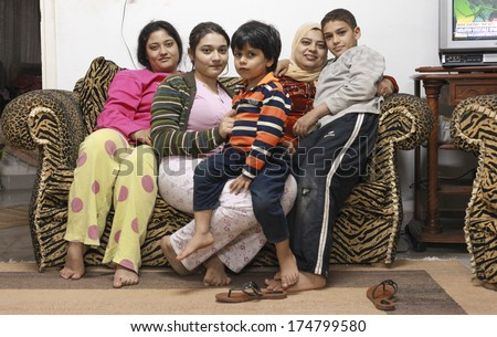 DAHAB, EGYPT - FEBRUARY 2, 2011: Egyptian family during riots in Cairo. Millions of protesters demanded the overthrow of the regime of Egyptian President Hosni Mubarak. - stock photo