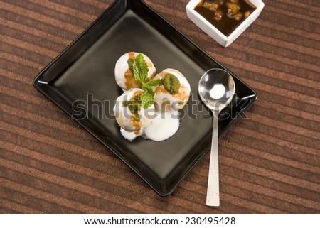 Dahi Bhalle Chaat or Stuffed Panipuri with Curd, Indian Dish - stock photo