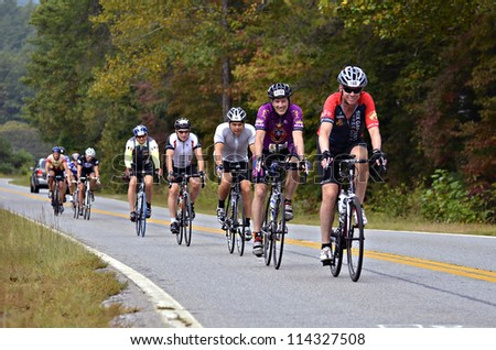 DAHLONEGA, GA/USA - SEPTEMBER 30: Unidentified men riding in a line at the Three and Six Gap Century ride, September 30, 2012 in Dahlonega GA. - stock photo