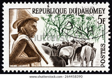 """DAHOMEY - CIRCA 1963: A stamp printed in Dahomey from the """"Dahomey Tribes """" issue shows Peuhl Herd-boy, circa 1963.  - stock photo"""