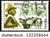"DAHOMEY - CIRCA 1963: A stamp printed in Dahomey (now Republic of Benin), shows Peuhl Herdsman and Cattle, without inscription, from the series ""Dahomey Tribes"", circa 1963 - stock photo"