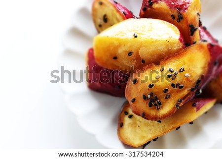 Daigakuimo are deep-fried and sugar coated satsumaimo sweet potatoes - stock photo