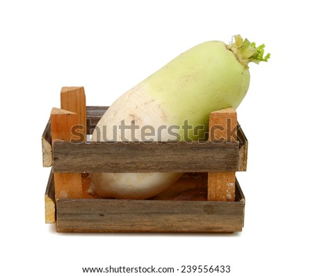 Daikon isolated in wooden crate on white background