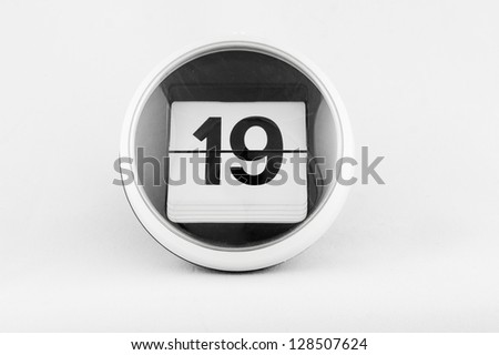 Daily calendar date change on a white background. day 19 - stock photo