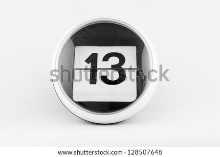Daily calendar date change on a white background. day 13 - stock photo