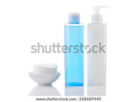 Daily cleansing cosmetics - face wash cleansing gel, smoothing toner and cotton cleansing pads isolated on white background. - stock photo