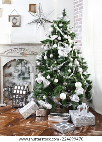 Daily interior in light tones decked out with Christmas tree and fireplace - stock photo
