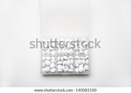 daily medicine tablet in plastic box on white background