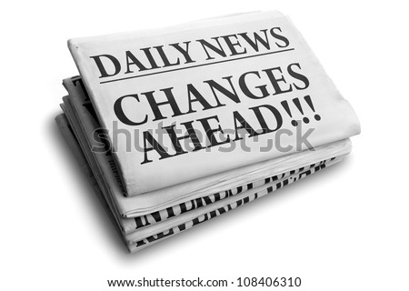 Daily news newspaper headline reading changes ahead - stock photo