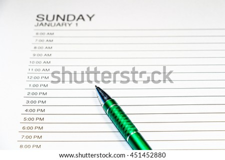 Daily planner or time planner with pen - stock photo
