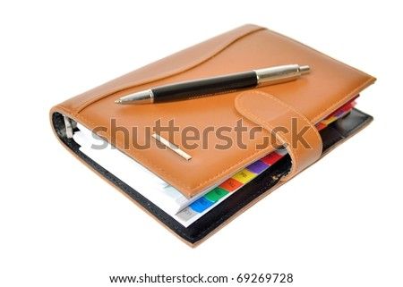 Daily planner with black pen - stock photo