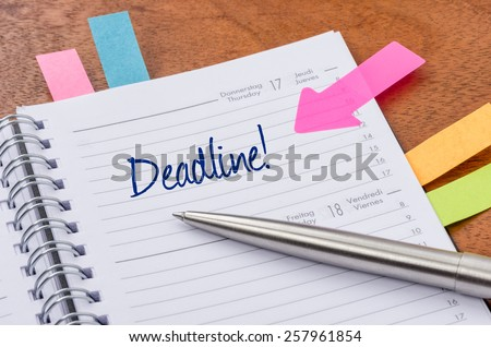 Daily planner with the entry Deadline - stock photo