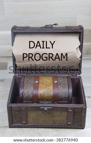 Daily program is written on the Brown torn paper in the treasure box