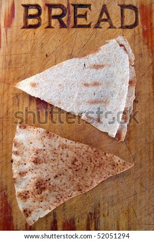 daily staple bread dipping triangles on board