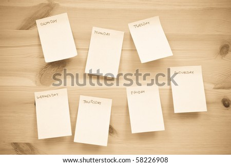Daily Task Sheets on wood - stock photo