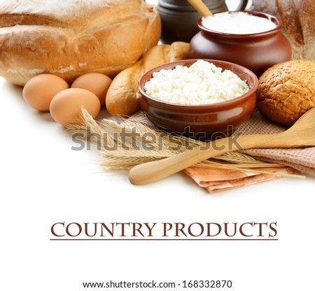Dairy products and bread on white background  - stock photo