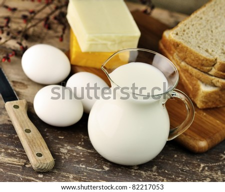 dairy products and Fresh eggs on a old wooden table