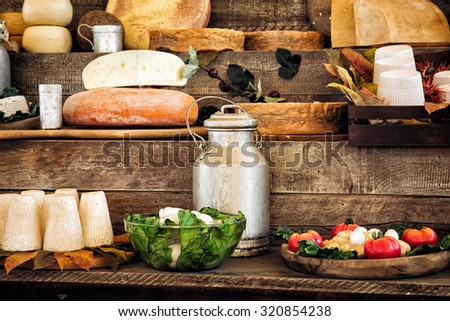 Dairy products and vegetables on the wooden background. - stock photo