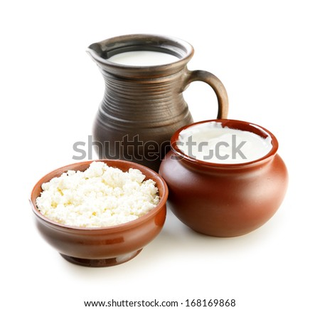 dairy products in brown ceramic bowl on a white background - stock photo