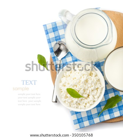 Dairy products, milk in a glass and pitcher, cottage cheese in a bowl,  checkered napkin  on a white background, top view , closeup  - stock photo