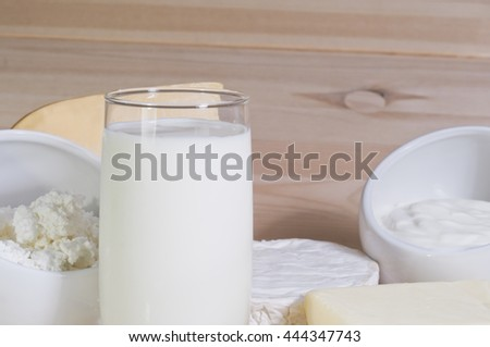 Dairy products: milk, yogurt, cheese, butter on wooden background