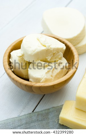dairy products on blue canvas cloth, white wooden table background