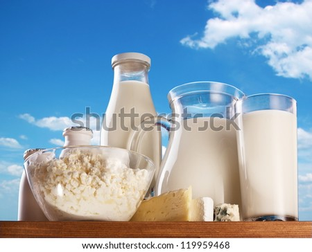 Dairy products on the sky background. - stock photo