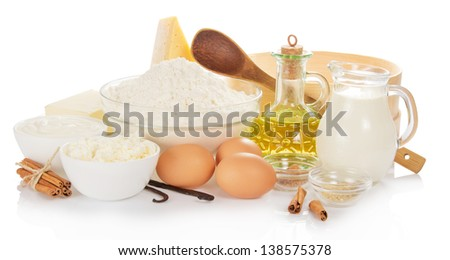 Dairy products, sunflower oil and the spices isolated on white