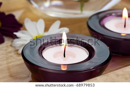 Daisies and candles - stock photo