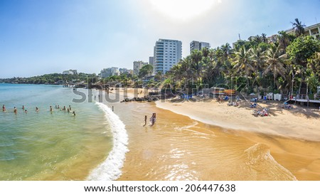 Dakar, Senegal - July 2014: Tourists and the local residents of Dakar spend their holidays on the beautiful beaches on July 11, 2014 in Dakar, Senegal - stock photo