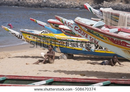 DAKAR, SENEGAL - MAY 27, 2014: Children and fishing boats on the beach of Ouakam