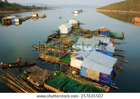 DAKLAK, VIET NAM- FEB 26: Asian residence on water, group of floating house of fishing village, beautiful Vietnamese countryside, impression panoramic, Dak Lak, Vietnam, Feb 26, 2015