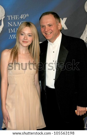Dakota Fanning and Joe Pichirallo at the 40th NAACP Image Awards. Shrine Auditorium, Los Angeles, CA. 02-12-09