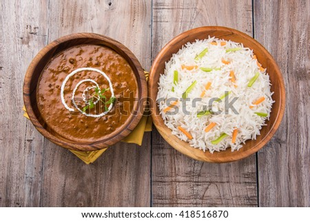 dal makhani or daal makhani or dal makhni with plain basmati rice, served in wooden bowl - stock photo
