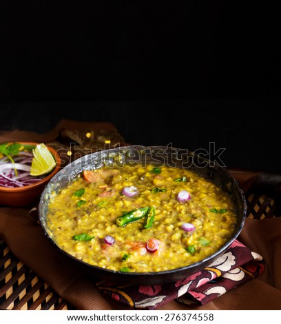 Dal Tadka Curry , Indian traditional dish  Lentils also known as Dal tempered with spices ,garnished with coriander leaves,chopped onions  and green chillies. Comfort food it is ! - stock photo