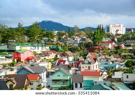 DALAT CITY, VIETNAM - NOVEMBER 1:  Many houses with tile roofs from hill in the Da Lat city (Dalat) in morning, Vietnam on November 1, 2015. - stock photo