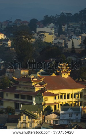 DALAT CITY, VIETNAM - NOVEMBER 1: Many houses with tile roofs from hill in the Da Lat city (Dalat) in morning, Vietnam on November 1, 2015.