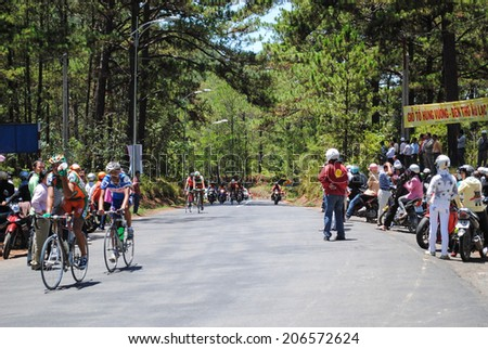DALAT, VIETNAM - APRIL 25: Riders racing on Bao Loc moutain pass during Ho Chi Minh Telecast Championship on April 25, 2010, in Dalat, Vietnam. - stock photo