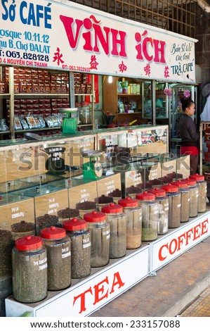 DALAT, VIETNAM - AUGUST 2, 2014: An unidentified woman sells tea and coffee at the city central market (Cho Da Lat), one of major tourist attractions in the city.