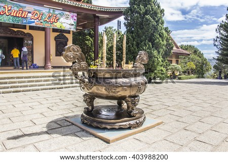 DALAT, VIETNAM - FEBRUARY 3, 2016: Truc Lam Pagoda, a buddhist Zen monastery near the city of Dalat, Vietnam. The picture shows the giant bowl in the center for burning incense.