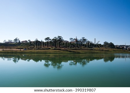 DALAT, VIETNAM - MARCH 4, 2016: Lanscape near by Xuan Huong Lake. This artificial lake in the city centre is a favourite place for tourists and locals for walking.