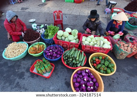 DALAT, VIETNAM - SEPTEMBER 30, 2015: local greengrocer on the street in Dalat market. Dalat is famous with weather,vegeteble and fruit.