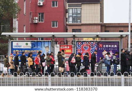 DALIAN-NOV. 11, 2012. Bus-stop with advertising on Nov. 11, 2012 in Dalian. China has 50,000 outdoor advertising companies. Outdoor advertising became third largest medium after TV and print media. - stock photo