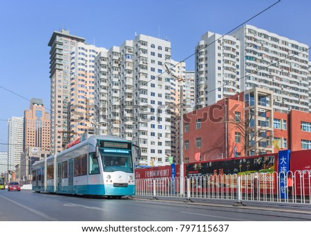 DALIAN-NOVEMBER 27, 2012. City scape with approaching tram. Dalian is the second largest city in Liaoning Province. In the prefecture live 5,893,692 people in an area of 13,238 square kilometer.