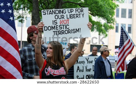DALLAS - APRIL 15: Taken in Dallas, Texas in front of City Hall on US Tax Day April 15, 2009. A crowd gathers to protest big government and increased taxes. - stock photo