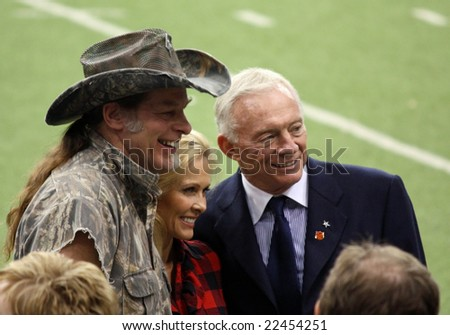 DALLAS - DEC 14: Sunday, December 14, 2008. Rock musician Ted Nugent his wife Shemane, and Jerry Jones, owner of the Dallas Cowboys. Prior to game between Dallas Cowboys & NY Giants. Taken in Texas Stadium. - stock photo